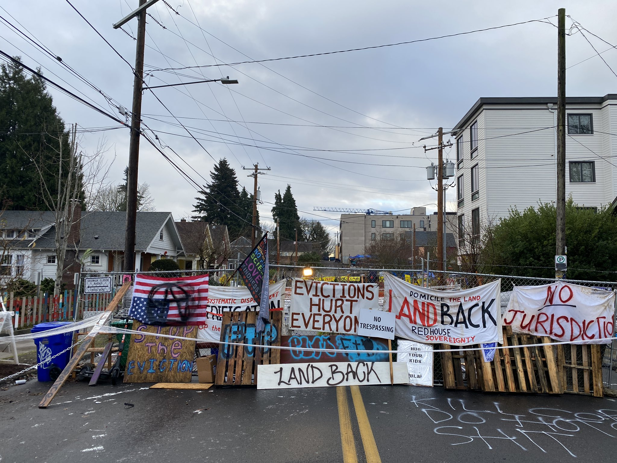 Protesters at Red House Eviction Defense Build-Up Barricades