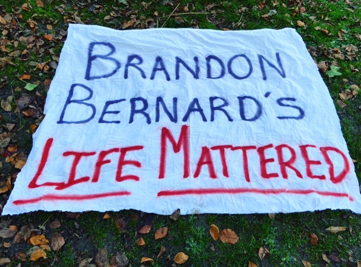 Demonstrators in Seattle Drop Banner Demanding Justice for Brandon Bernard
